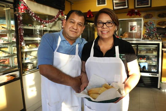 Panaderia Las Palomas owners Merced and Maria Perez pose for a portrait in their shop in Reno on Dec. 19, 2018.