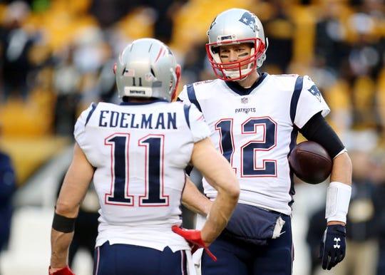 New England Patriots quarterback Tom Brady talks with wide receiver Julian Edelman.