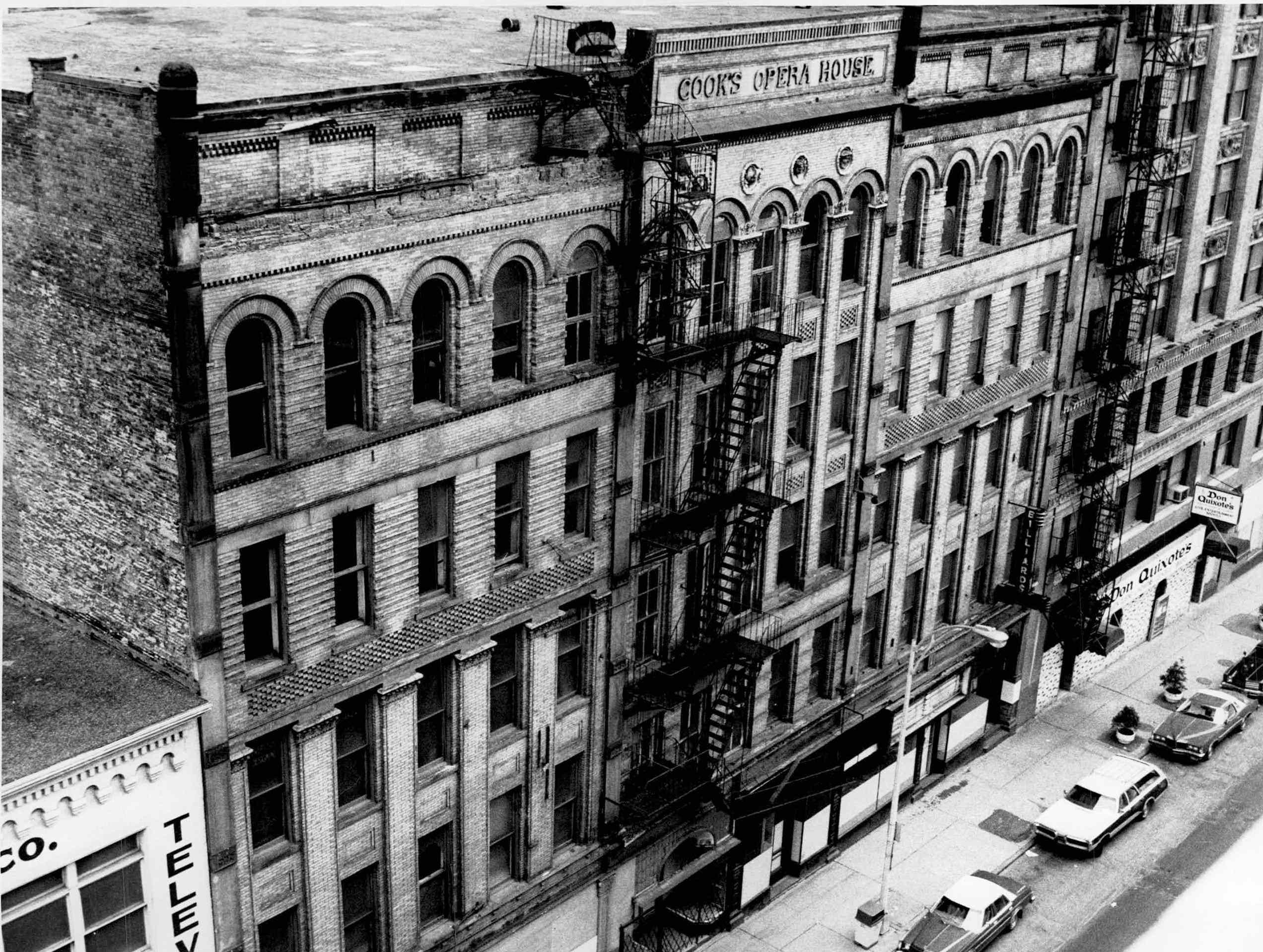 This 1977 photo shows Cook's Opera House and other buildings located on South Avenue before they were torn down for the Rochester Riverside Convention Center.