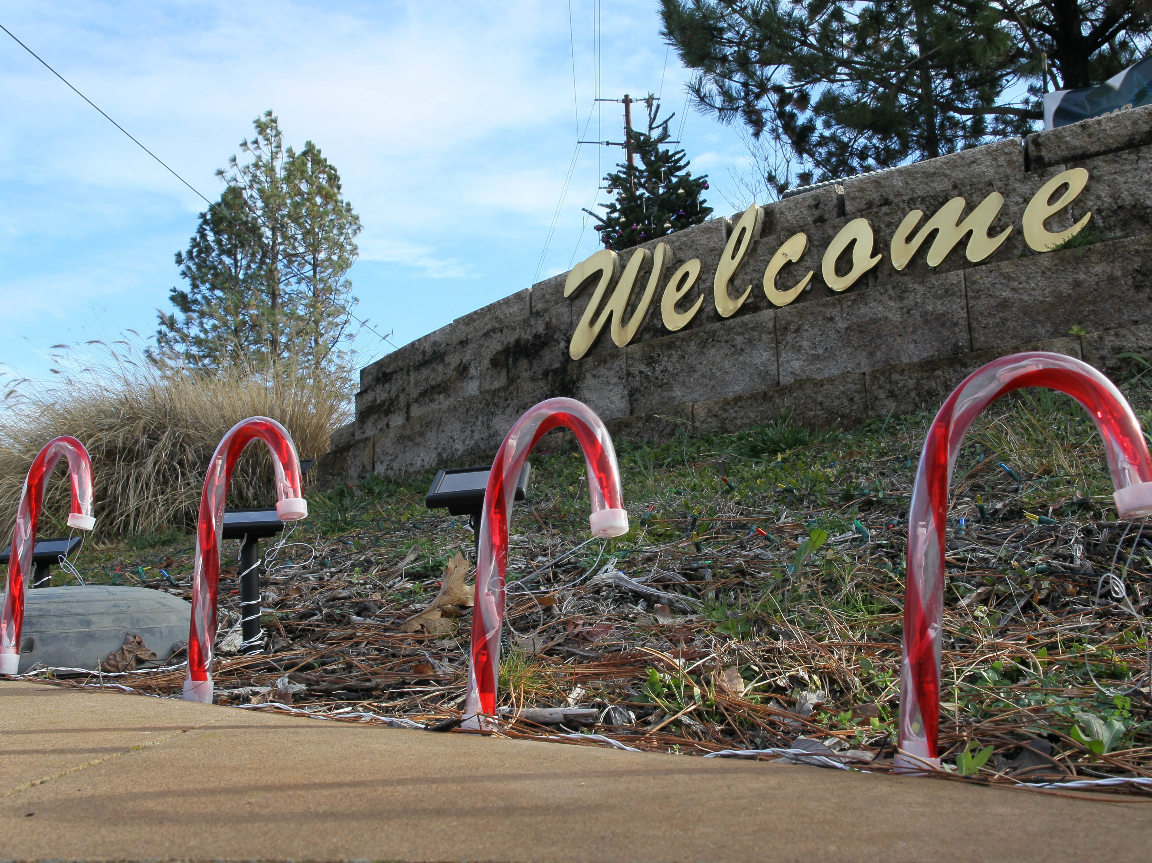 "Candy canes placed in front to the ""Welcome to Paradise"" sign along Skyway welcome back residents. Residents whose homes were burned were allowed to return for the first time on Tuesday after the Camp Fire displaced them on Nov. 8, 2018."