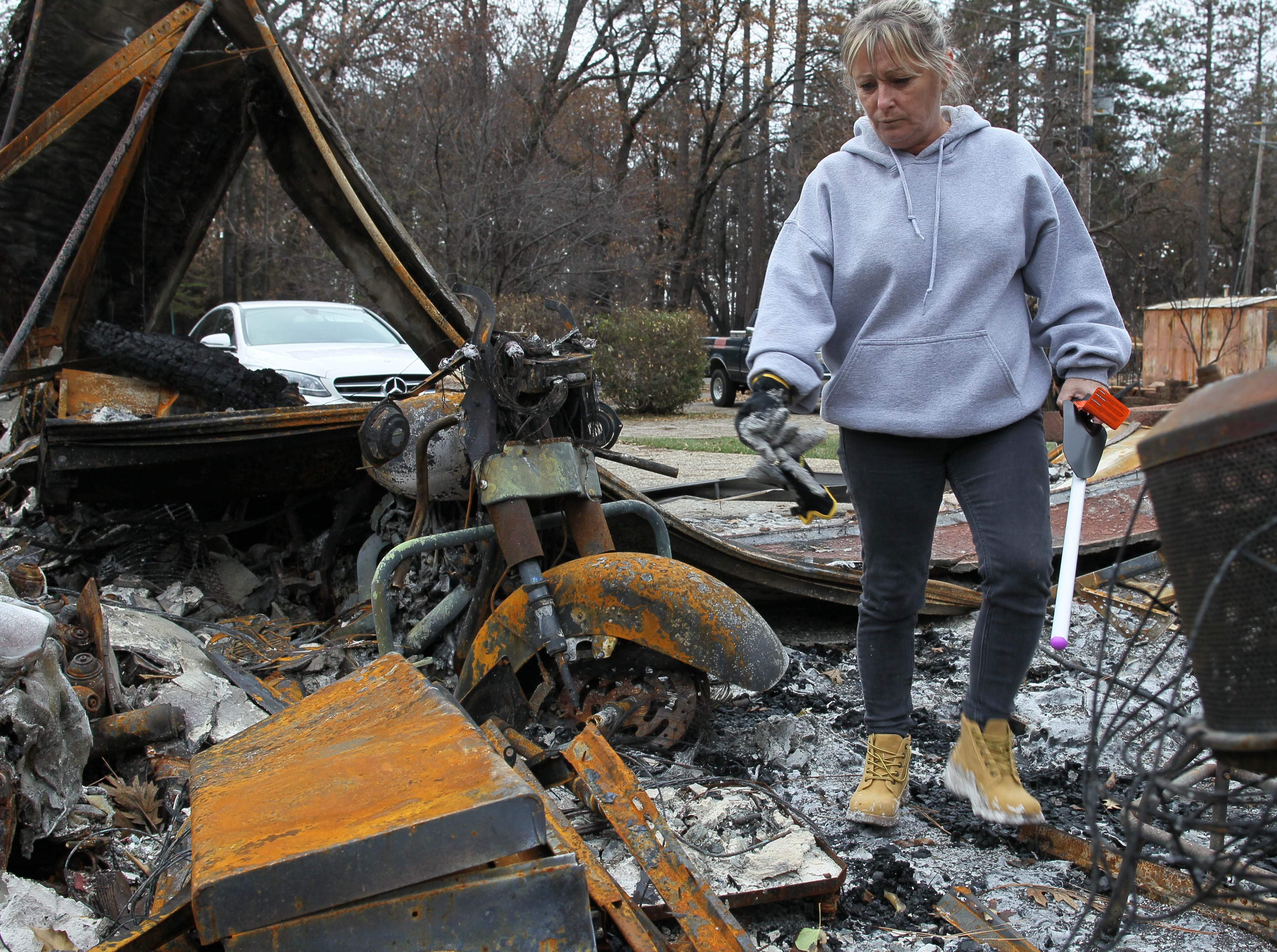 Tina Torres walks through her burned house on Tuesday. It was the first day she and other Paradise residents were allowed to return to their home sites since they were evacuated during the Camp Fire on Nov. 8, 2018. (Hung T. Vu/Special to the Record Searchlight)