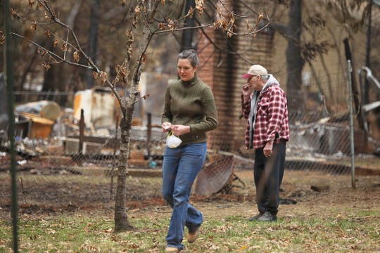 Megan Wilson walks back to her property after greeting her neighbor in the backyard of their fire-destroyed home. (Hung T. Vu/Special to the Record Searchlight)