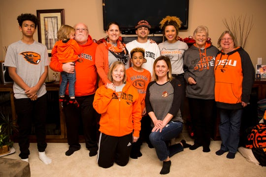 Anthony Gould and his family at his home in West Salem on Wednesday, Dec. 19, 2018. Gould graduated early to join Oregon State's football team in January.