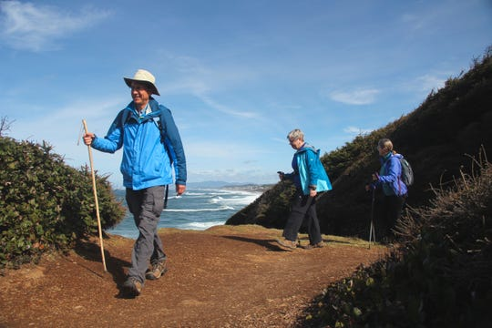 Dan Hilburn, from left, Connie Soper and Lucy Hilburn are advocates for connecting the Oregon Coast Trail. There are 33 gaps in the trail that total approximately 50 miles.
