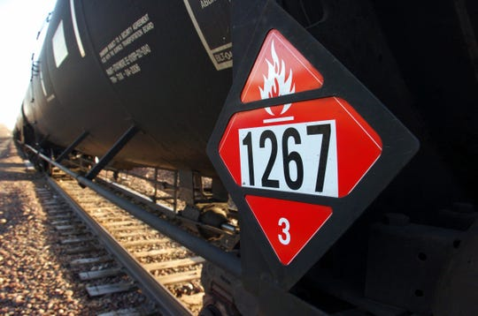 A warning placard on a tank car carrying crude oil near a loading terminal in Trenton, N.D.