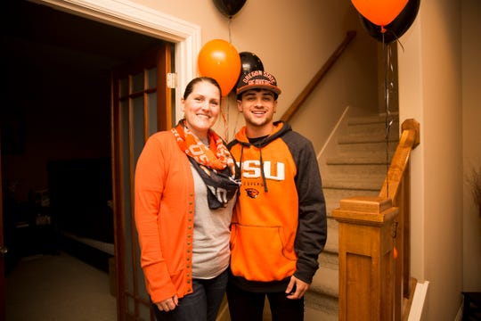 Anthony Gould and his mother, Stacy Johnson, in West Salem on Wednesday, Dec. 19, 2018. Gould graduated from West Salem High School early to join Oregon State's football program in January.