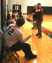 Assistant Coach Will Silcox of the Silverton Unified picks players for the first round of scrimmages.