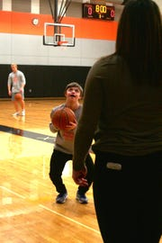 Sean Kuga shoots with a teammate before scrimmage begins for the Silverton Unified basketball team.