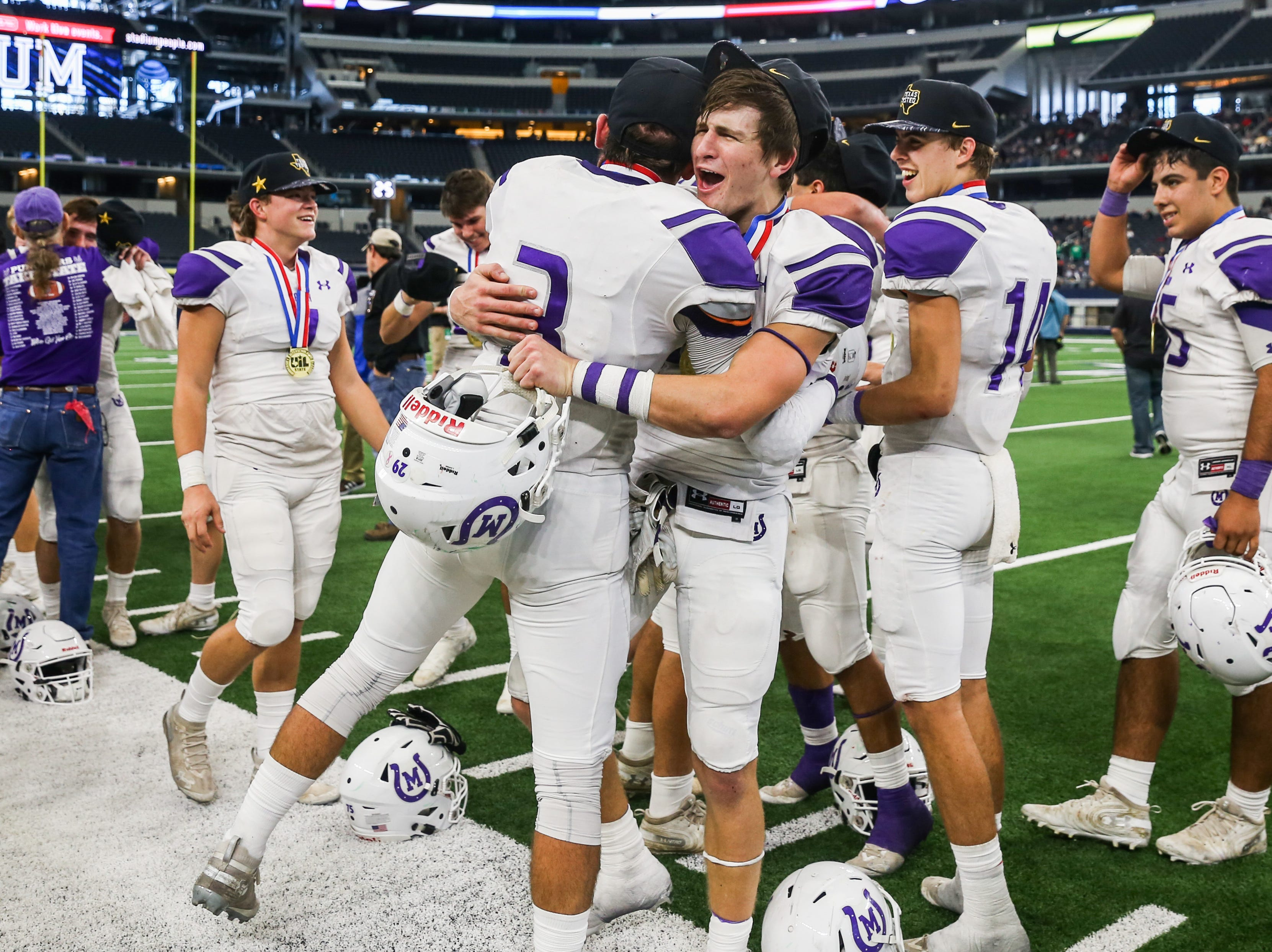 Mason players celebrate as they win the state finals game against New Deal Thursday, Dec. 20, at the AT&T Stadium.