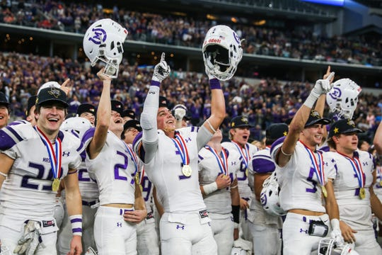 Mason players celebrate after winning the state final against New Deal on Thursday, Dec. 20, 2018, at AT&T Stadium.