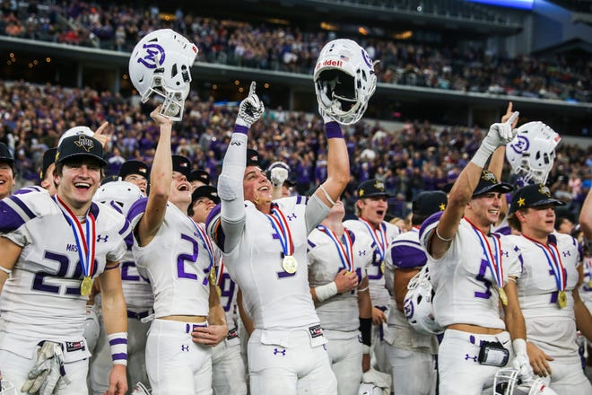Mason players celebrate after their win in the state final against New Deal on Thursday, Dec. 20, at AT&T Stadium in Arlington.