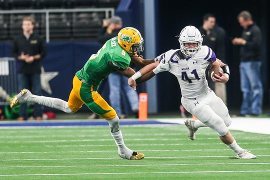 Mason's Klay Klaerner runs the ball during the state final game against New Deal on Thursday, Dec. 20, at AT&T Stadium.