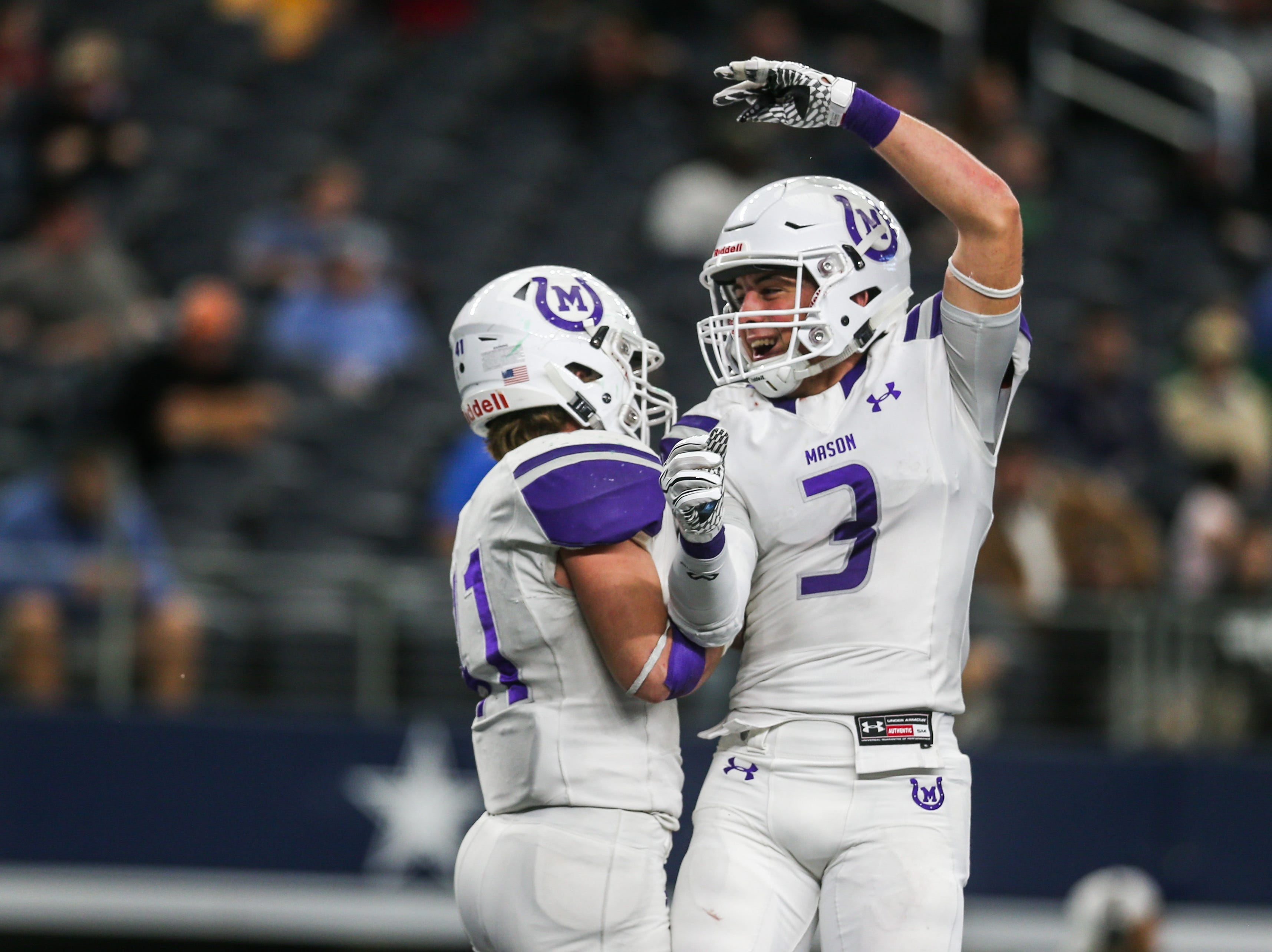 Mason players celebrate a touchdown during the state finals game against New Deal Thursday, Dec. 20, at the AT&T Stadium.