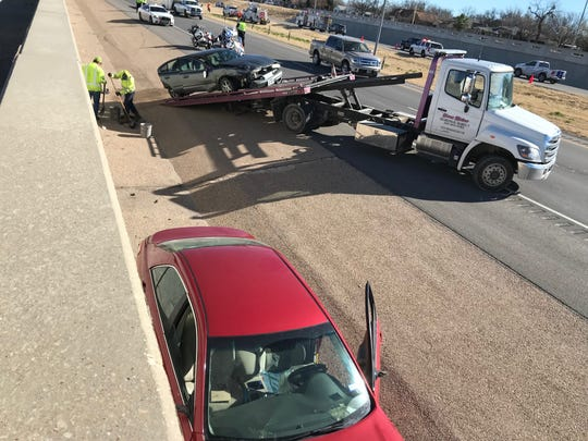 A car is being towed from a two car wreck in the 2400 block of W. Houston Harte on Thursday, Dec. 20. This wreck happened shortly after another wreck in the same block.