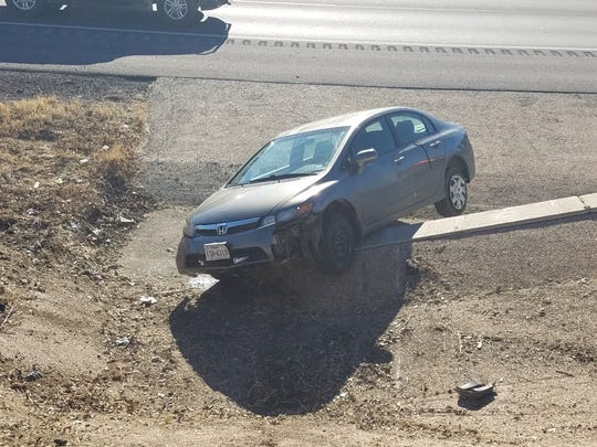 A 2012 Chrysler balances on a jersey barrier in the 2400 block of W. Houston Harte on Thursday, Jan. 20, 2018. The female driver was unable to get out until help arrived.