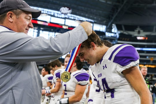 A championship medal is put around Mason's Otto Wofford after the victory over New Deal Thursday, Dec. 20, at the AT&T Stadium.