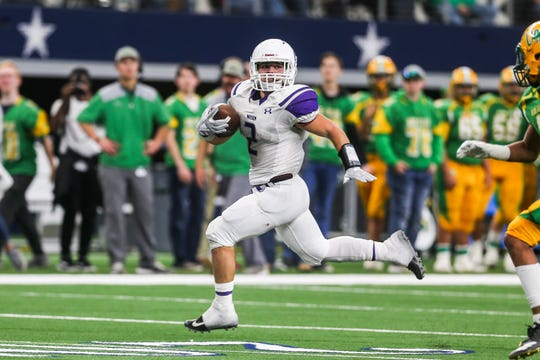 Mason's Jake Cockerham runs the ball during the state finals game against New Deal Thursday, Dec. 20, at the AT&T Stadium.
