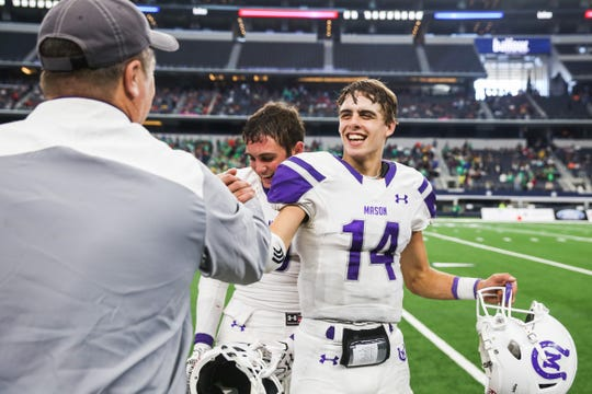 Mason's Otto Wofford celebrates the win at state finals game against New Deal Thursday, Dec. 20, at the AT&T Stadium.