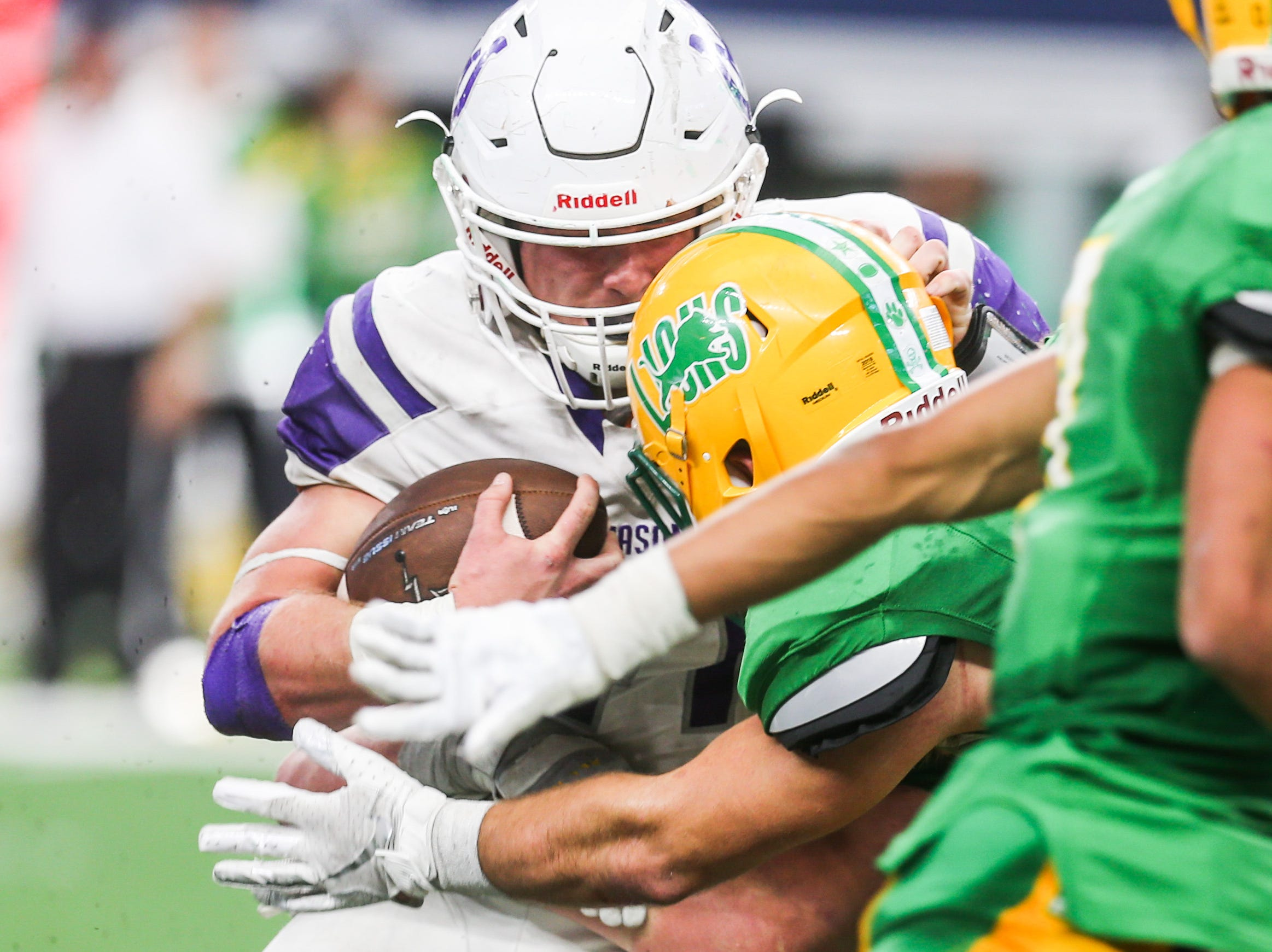 Mason's Klay Klaerner is tackled by New Deal during the state finals game Thursday, Dec. 20, at the AT&T Stadium.