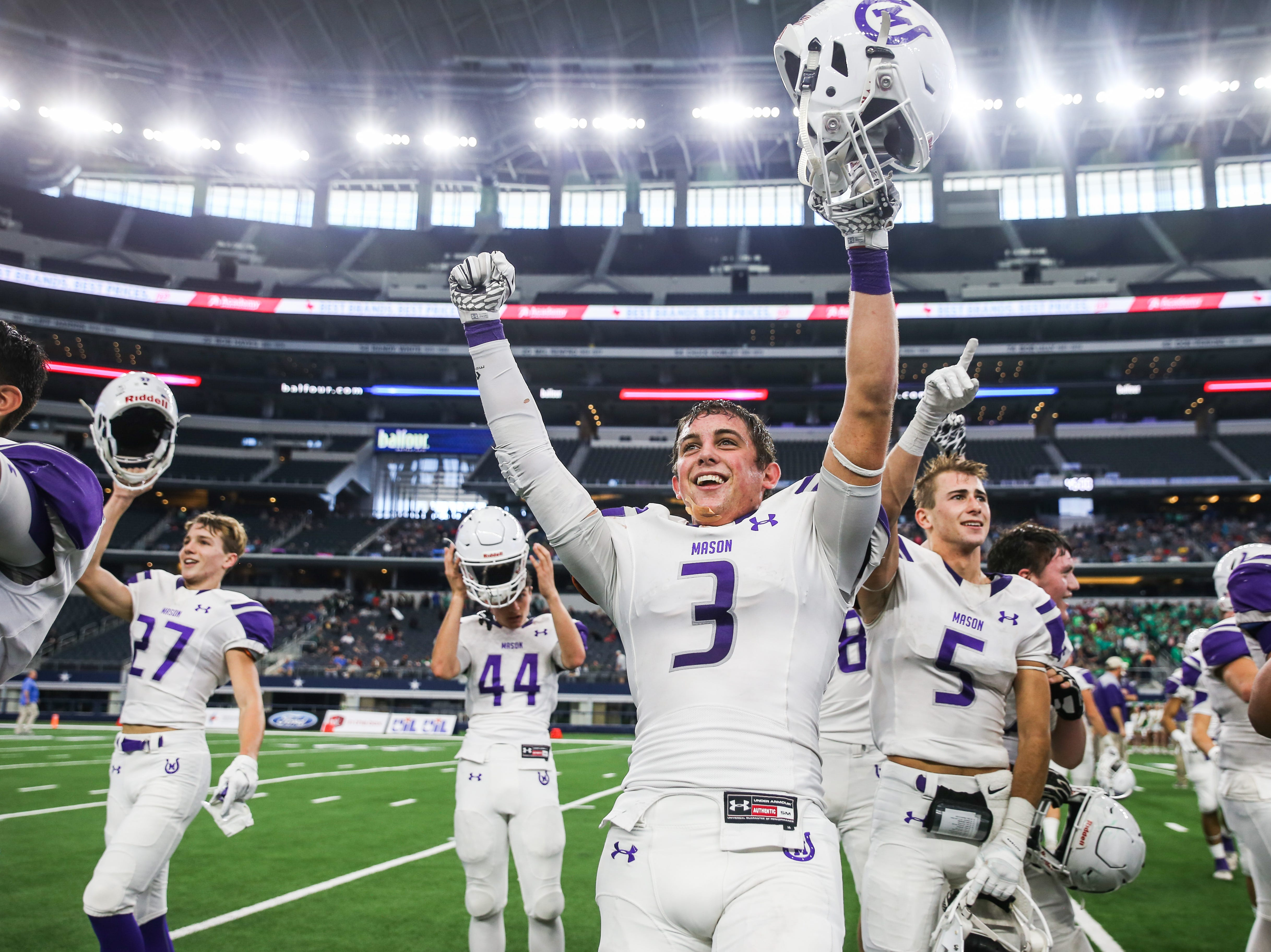 Mason players cheer as they win the state finals game against New Deal Thursday, Dec. 20, at the AT&T Stadium.