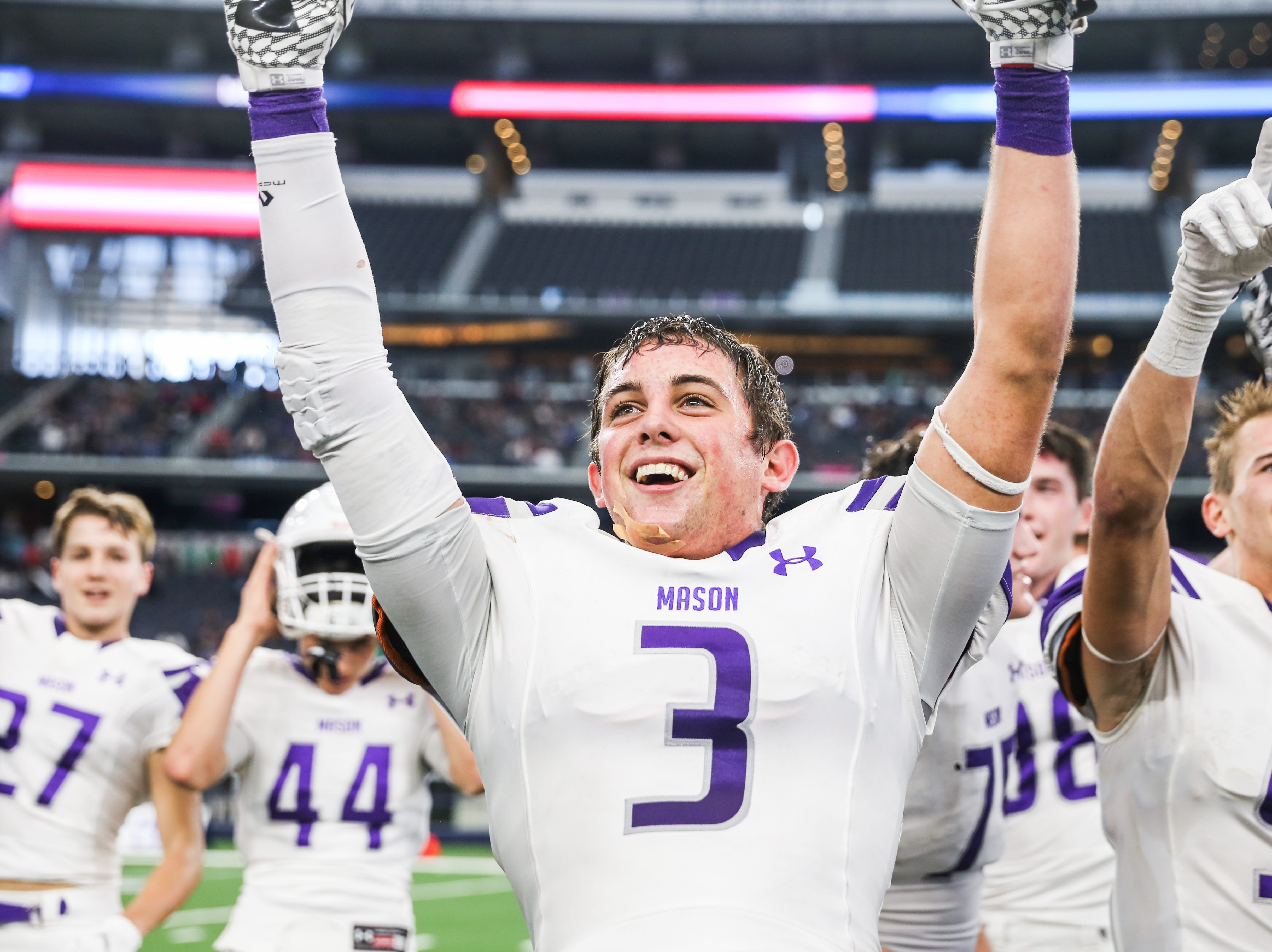 Mason Rudy Rochat cheer as they win the state finals game against New Deal Thursday, Dec. 20, at the AT&T Stadium.