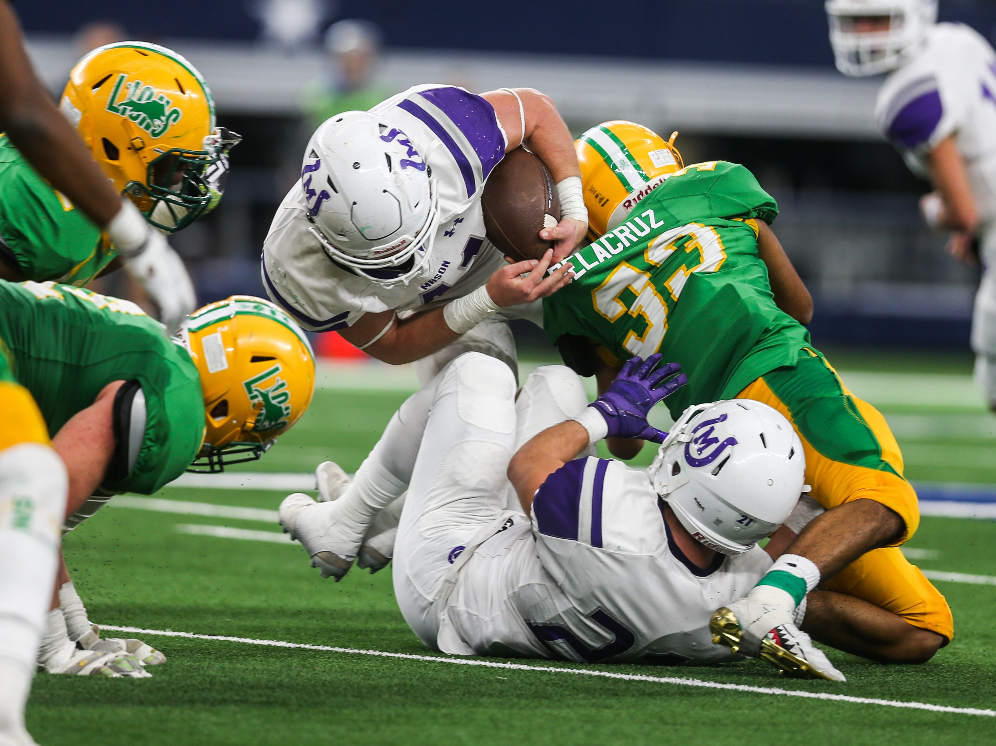 Mason's Klay Klaemer is tackled during the championship game against New Deal on Thursday, Dec. 20, 2018 at the AT&T Stadium in Arlington.