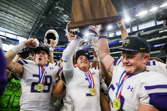 Mason players, including Slone Stultz (closest to camera) celebrate after winning the Class 2A Division I state final against New Deal on Thursday, Dec. 20, at AT&T Stadium in Arlington.