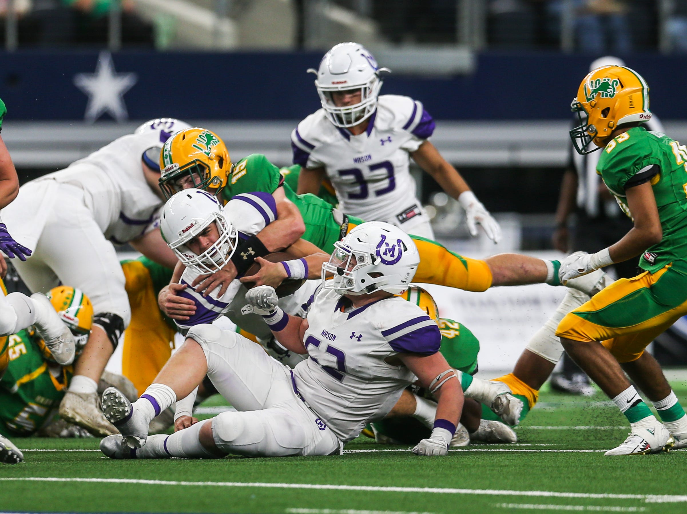 Mason's ball carrier is tackled by New Deal during the championship game Thursday, Dec. 20, at the AT&T Stadium.