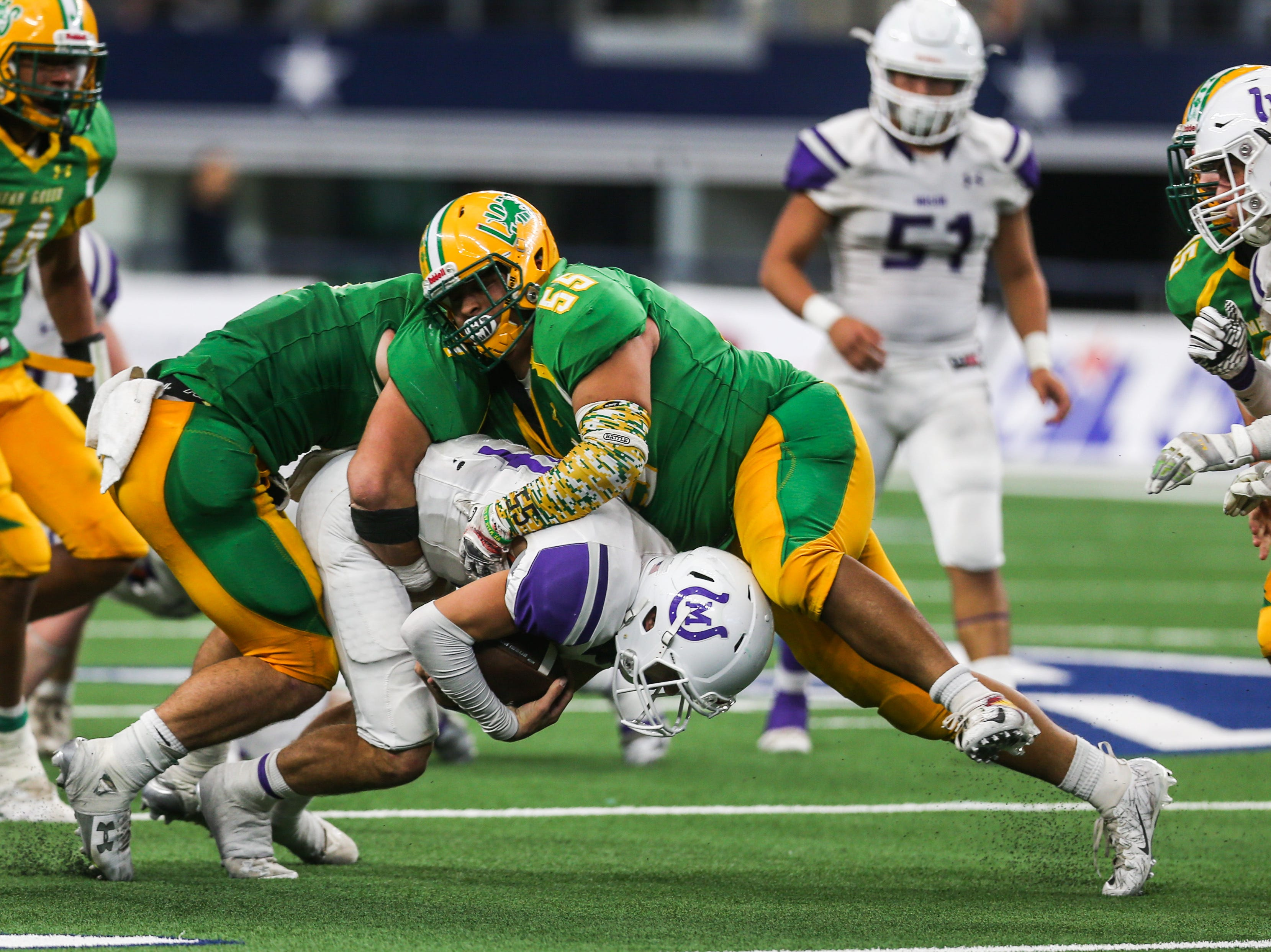 Mason's Otto Wofford is tackled by New Deal during the championship game Thursday, Dec. 20, at the AT&T Stadium.