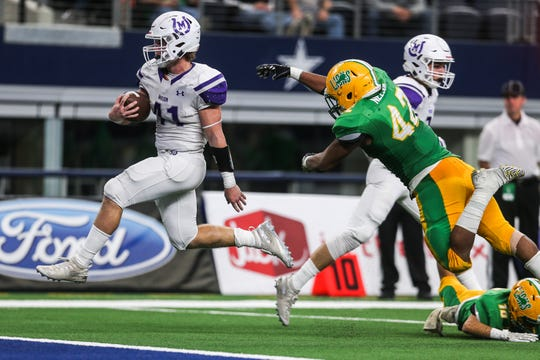 Mason's Klay Klaerner runs the ball during the state finals game against New Deal Thursday, Dec. 20, at the AT&T Stadium.