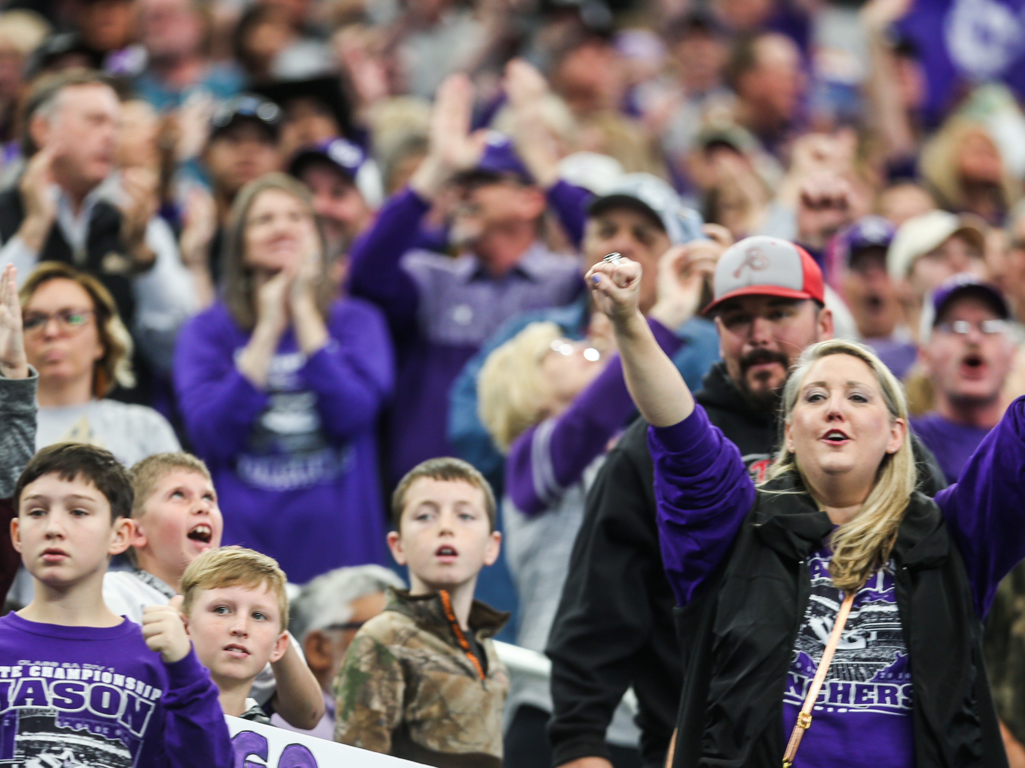 Mason fans cheer at a touchdown during the championship game against New Deal Thursday, Dec. 20, at the AT&T Stadium.
