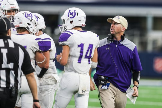 Mason's head coach Kade Burns chats with the players during the championship game against New Deal on Thursday, Dec. 20, 2018 at the AT&T Stadium in Arlington.