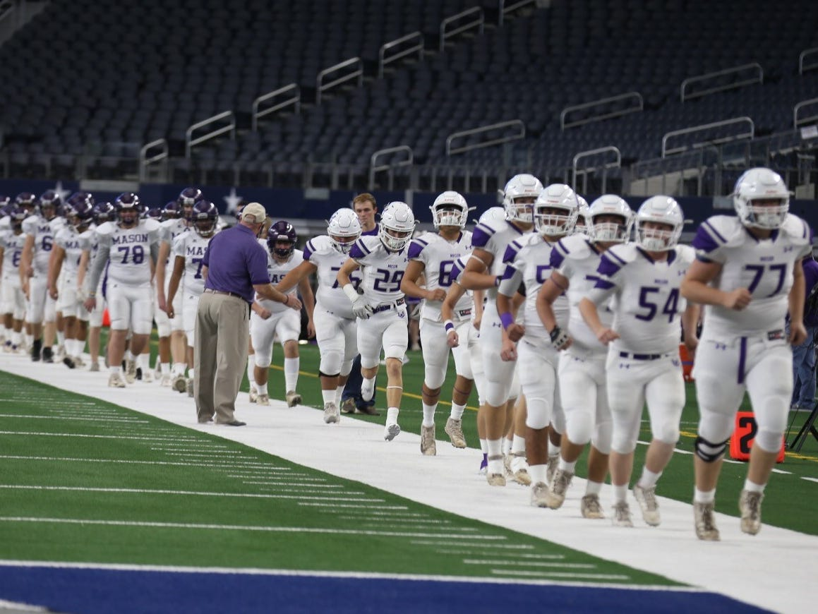The Mason Punchers warm up before the Class 2A Division I football state final against the New Deal Lions on Thursday, Dec. 20, 2018 at AT&T Stadium in Arlington.