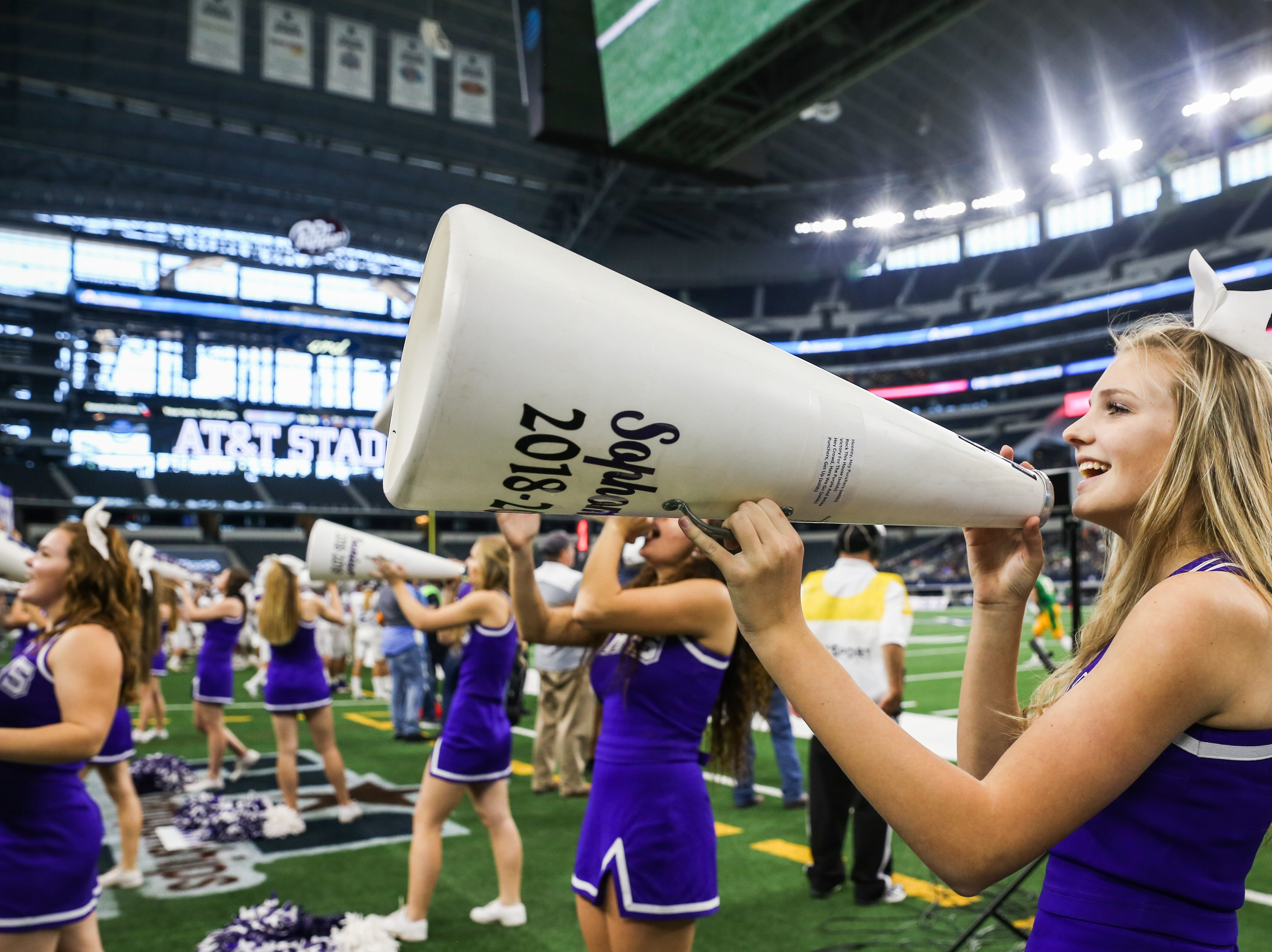 Mason cheer rally up the crowd for the state finals game against New Deal Thursday, Dec. 20, at the AT&T Stadium.