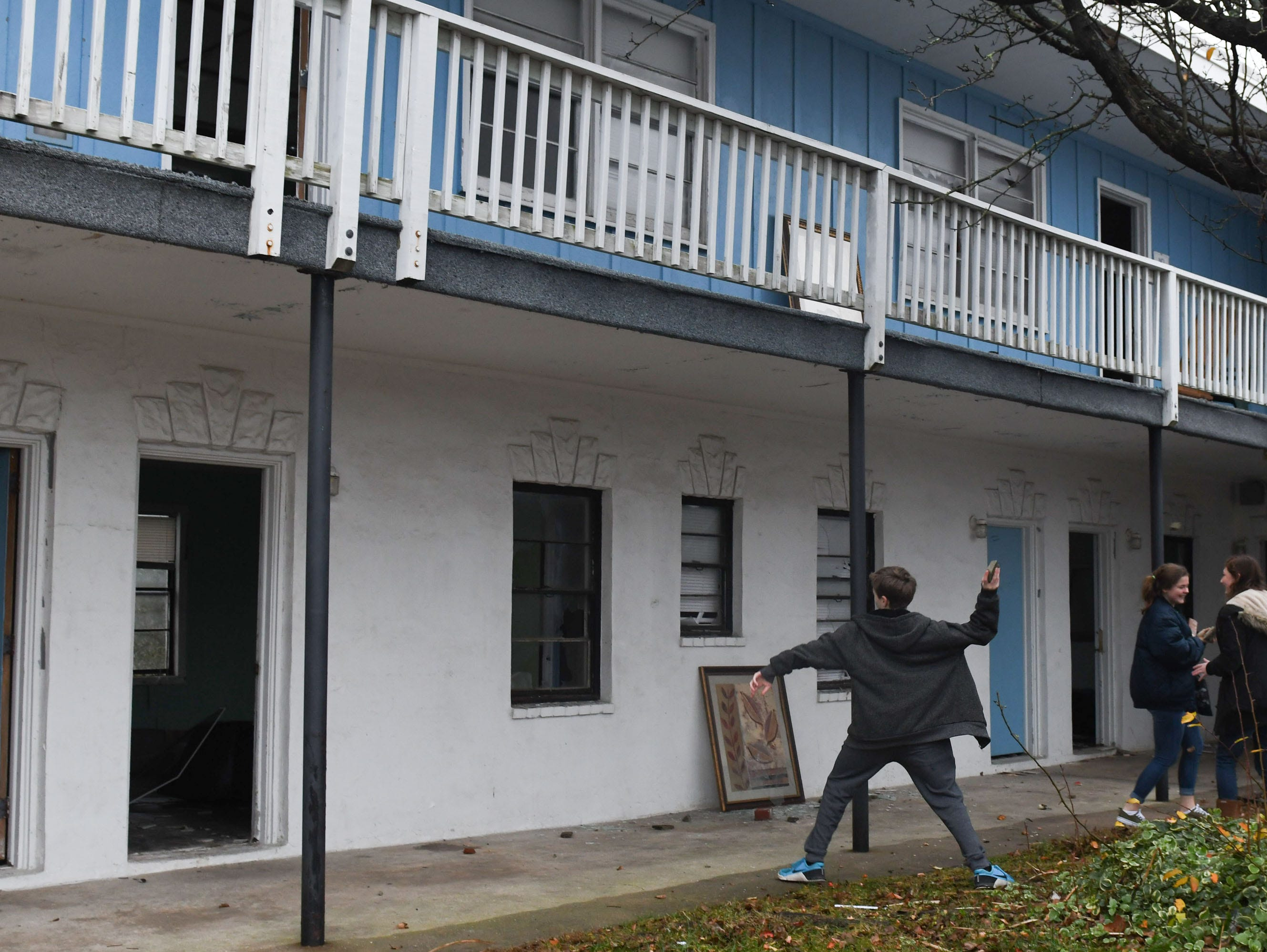 """The community said good bye to the Sands Motel located in Fenwick Island, Del. on Thursday, Dec. 20, 2018. During a """"Demo Party"""" held by the owners of the property. Anyone could come throw some rocks to break the windows before the demo began."""