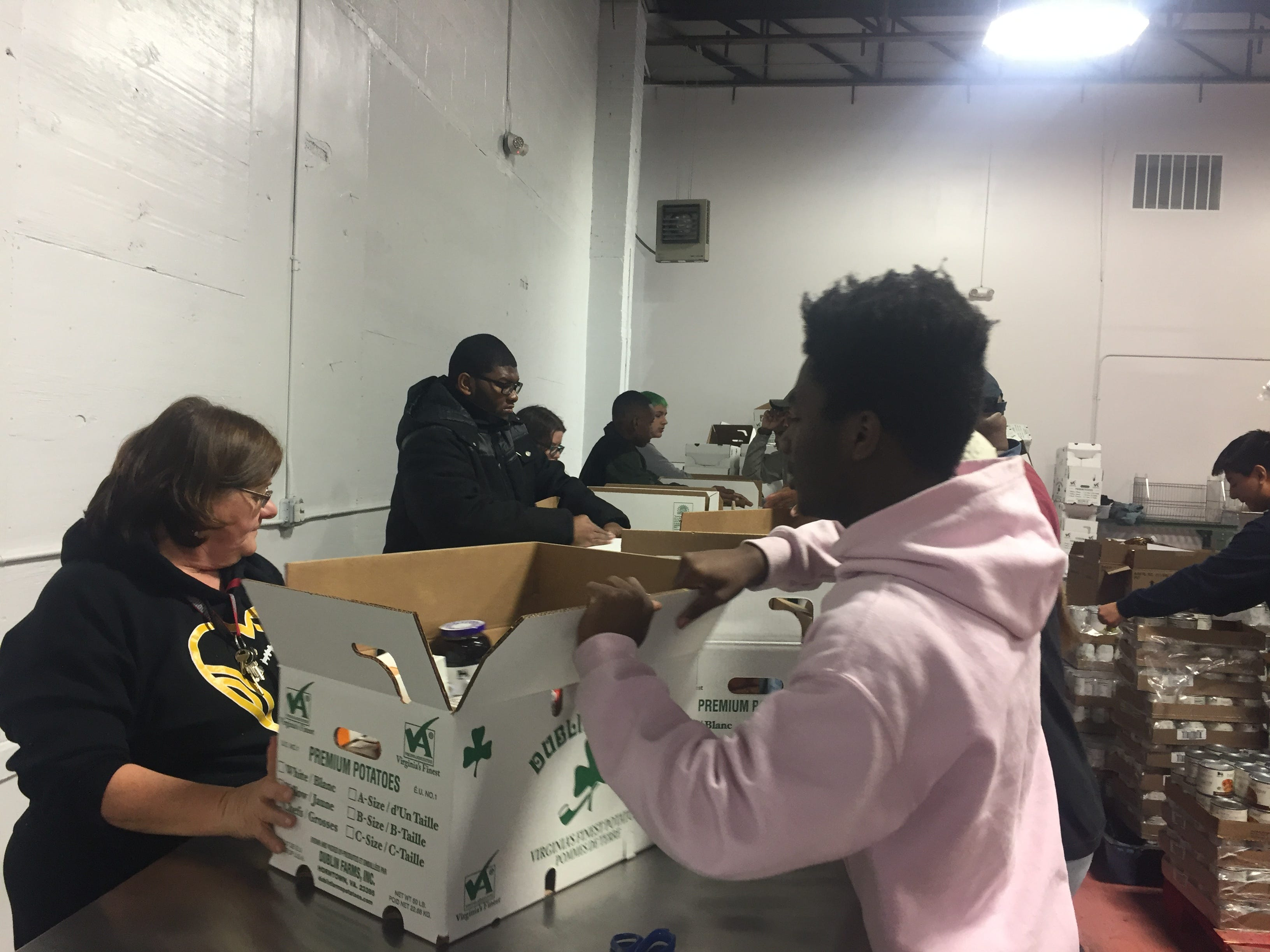 Nandua High School band members and band director Kendra Powell pack boxes of food for the Eastern Shore News' 58th Annual Bank of Cheer in Tasley, Virginia on Wednesday, Dec. 19, 2018.