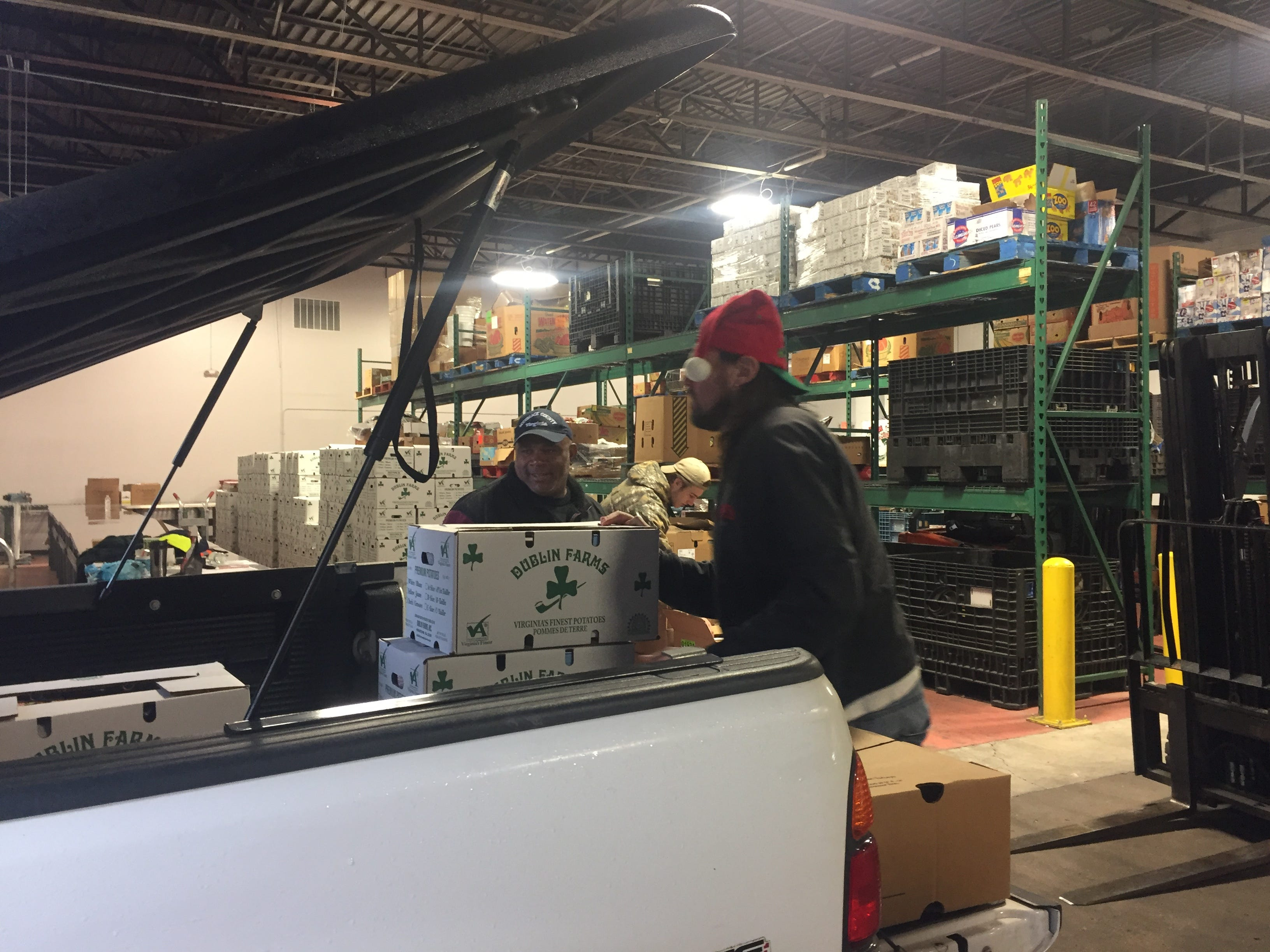 Volunteers load some of the 200 boxes of food being delivered to Eastern Shore of Virginia residents for the Eastern Shore News' 58th Annual Bank of Cheer campaign in Tasley, Virginia on Thursday, Dec. 20, 2018.