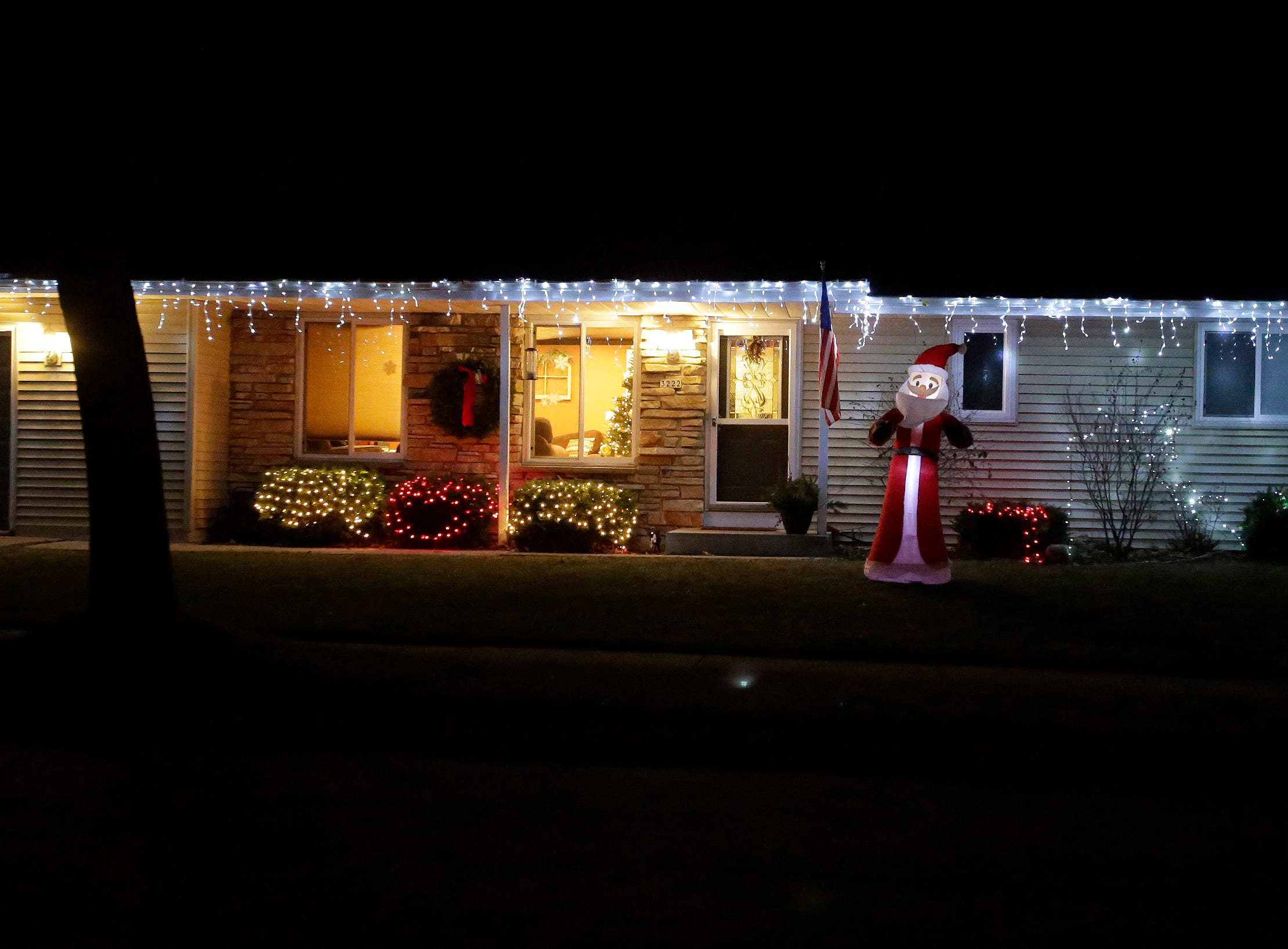 Santa welcomes visitors to this North 21st Street home, Wednesday, December 19, 2018, in Sheboygan, Wis.