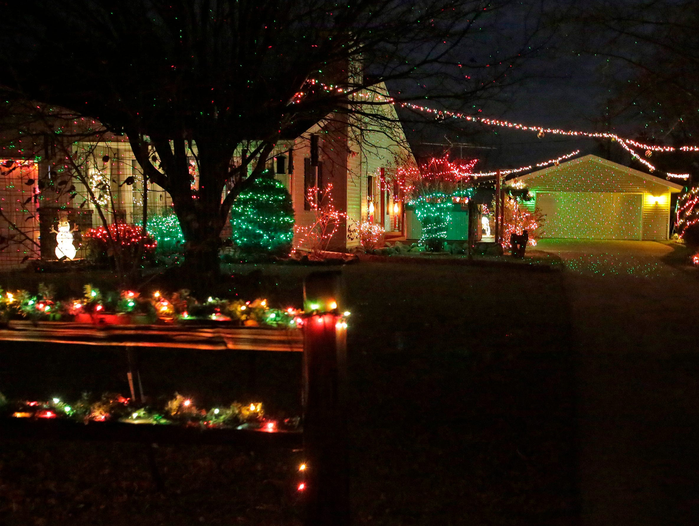 A home along North 20th Street is a study in lights, Wednesday, December 19, 2018, in Sheboygan, Wis.