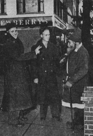 Andrew Jensen listens to the wishes of two soldiers from the airbase in 1942.