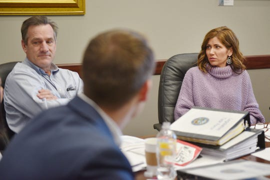 Gov.-elect Kristi Noem sits down for a 1:30 p.m. meeting with lieutenant governor running mate Larry Rhoden at the South Dakota State Capitol Wednesday, Dec. 19, in Pierre.