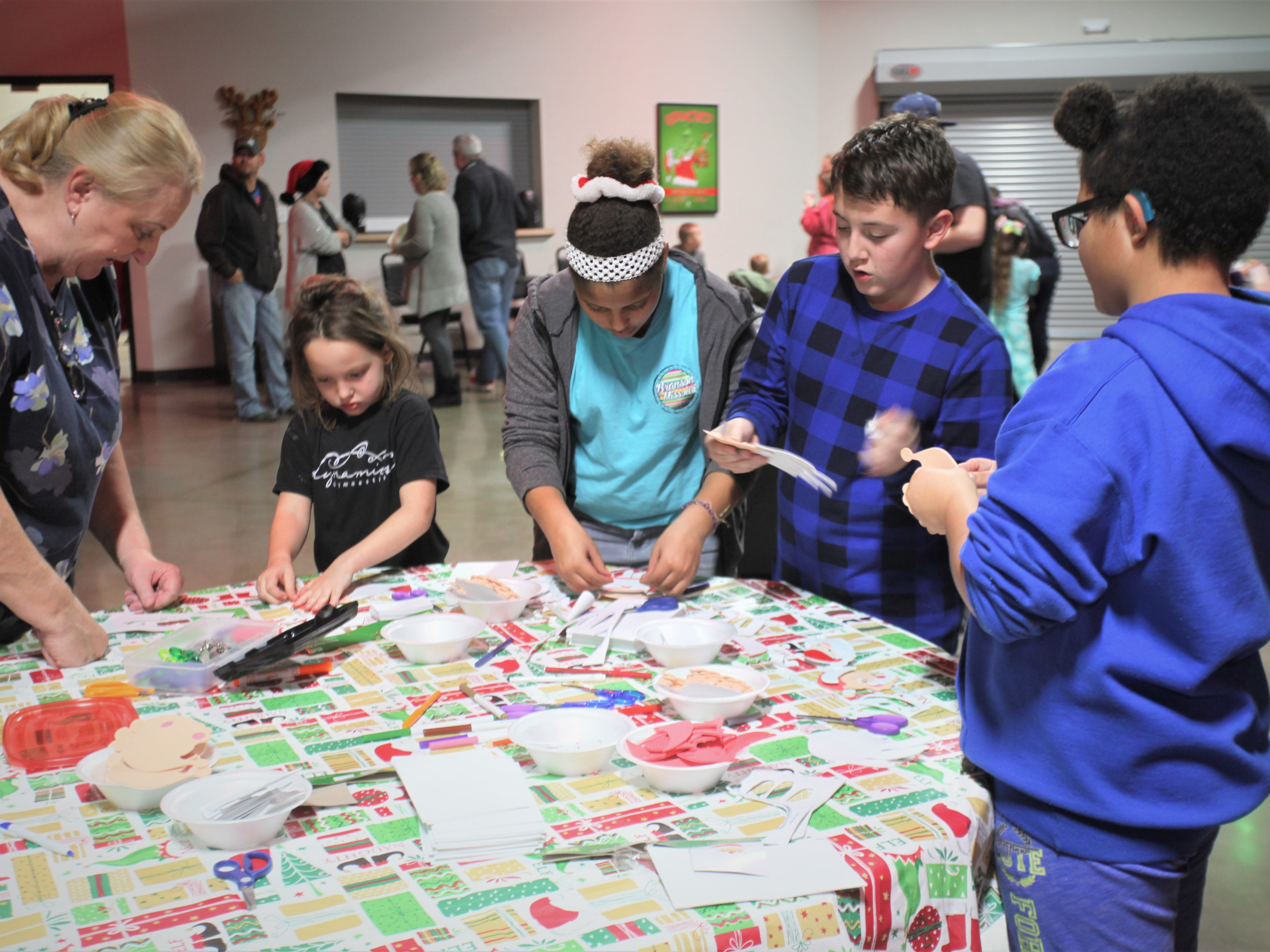 """Children complete crafts before a viewing of """"How the Grinch Stole Christmas"""" at Jesus Was Homeless Dec. 19."""