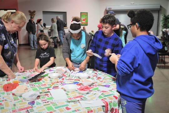 "Children complete crafts before a viewing of ""How the Grinch Stole Christmas"" at Jesus Was Homeless Dec. 19."