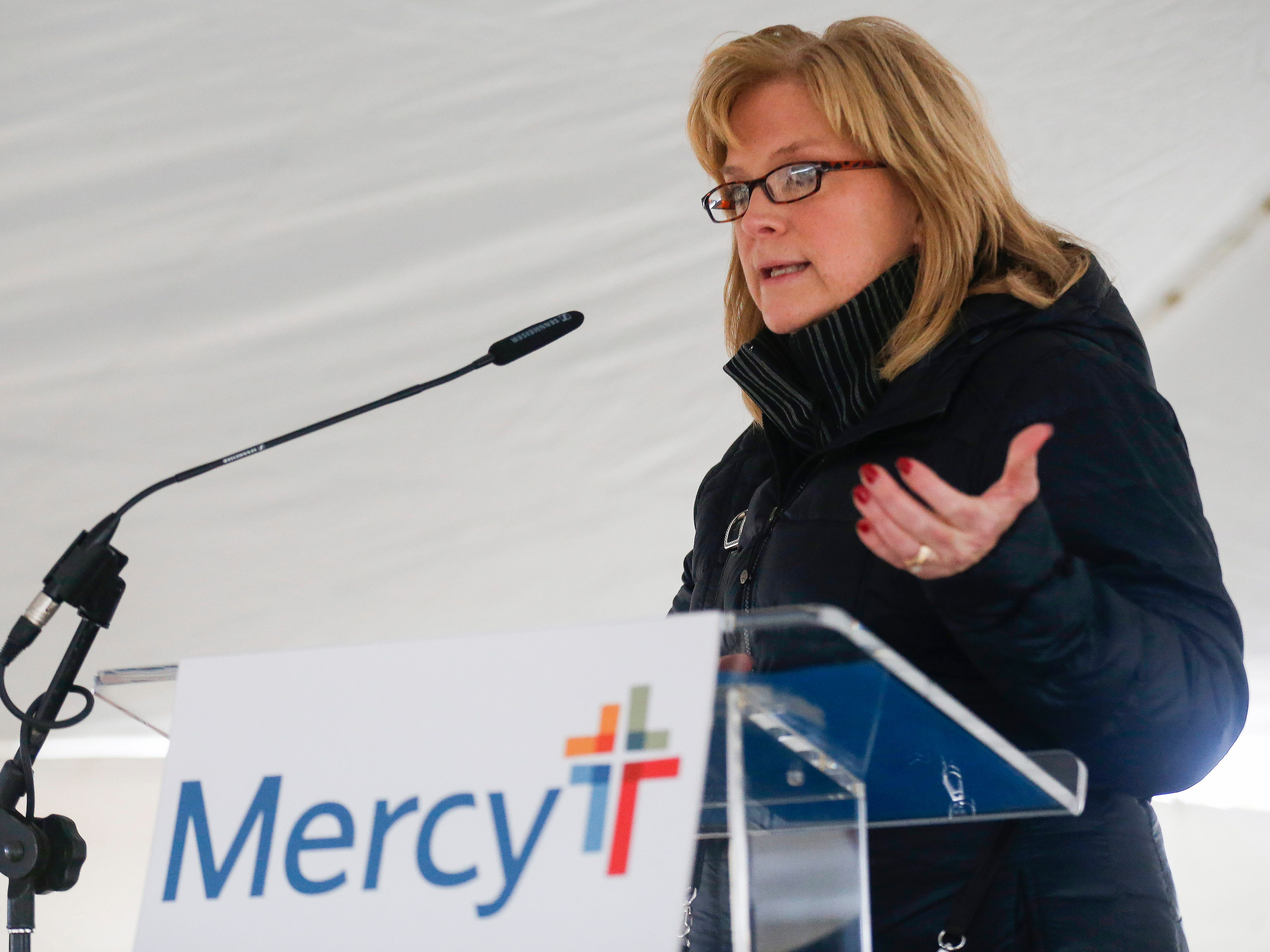 Dr. Jennifer McNay, vice president of primary care at Mercy, speaks during the groundbreaking and blessing for the new Mercy clinic which will be located at Republic Road and Scenic Avenue.