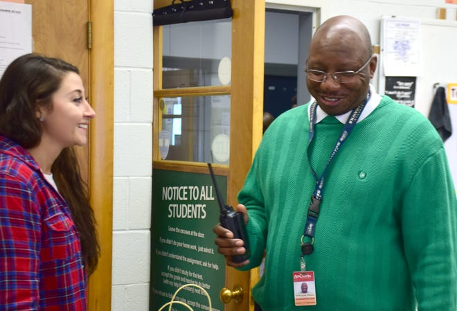 Robert E. Lee High School Assistant Principal DeWayne Moore, right, shares a laugh with science teacher Kelsee Green during a visit to her classroom on Friday, Dec. 14, 2018.