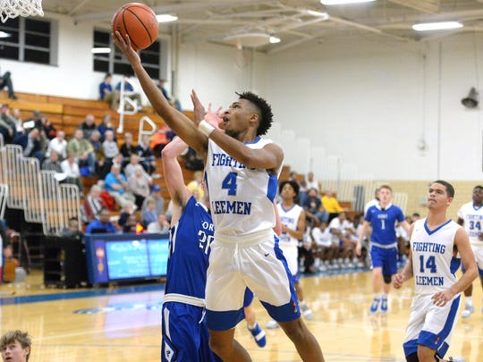 Lee High's Aarian Brown goes to the basket Wednesday in his team's win over Fort Defiance.