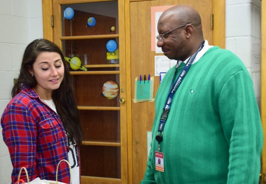 Robert E. Lee High School Assistant Principal DeWayne Moore, right, talks with science teacher Kelsee Grant during a visit to her classroom on Friday, Dec. 14, 2018.