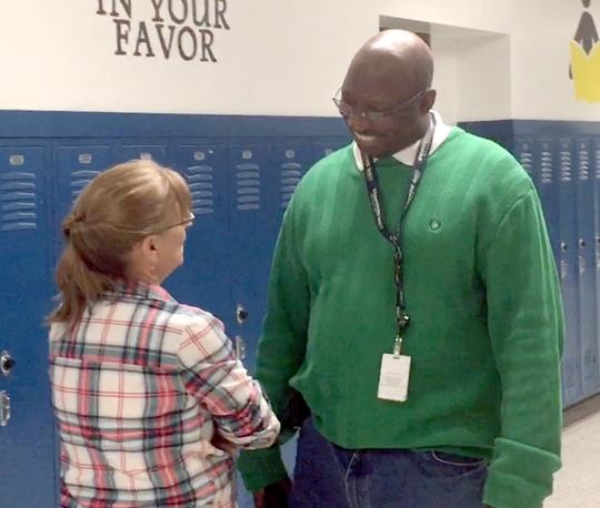 Robert E. Lee High School Assistant Principal DeWayne Moore, right, talks with a teacher during his patrol of the school's hallways on Friday, Dec. 14, 2018.