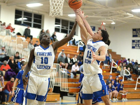 Lee High's Darrion Simms (13) and Kaleb Hall (10) work for a rebound against Fort Defiance Wednesday night.