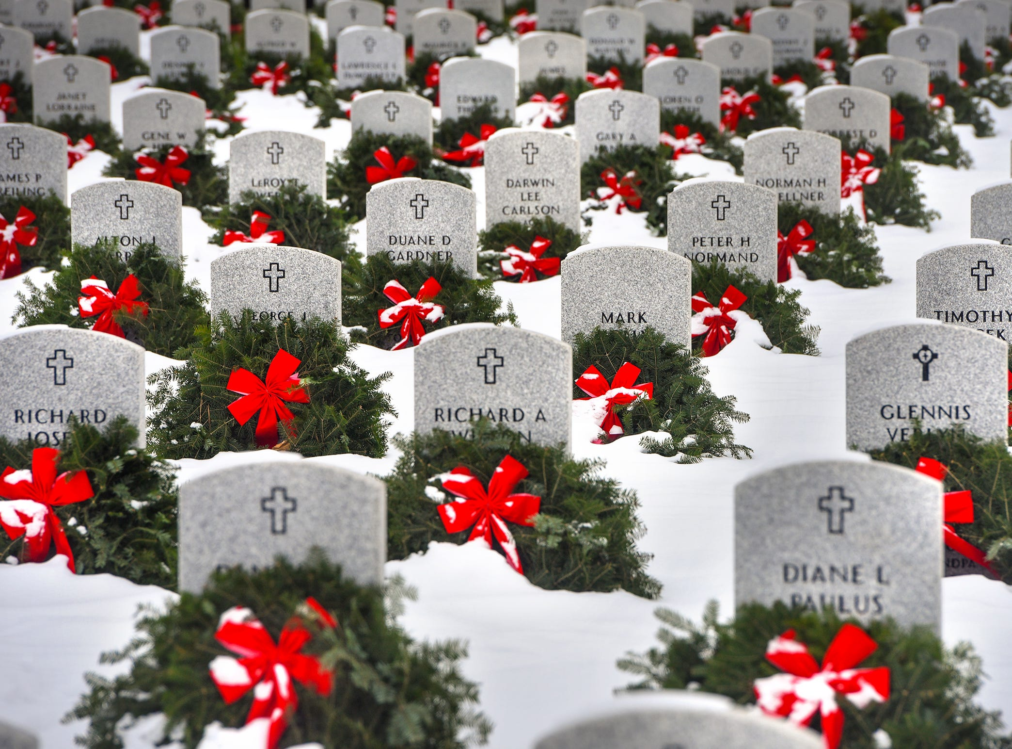 New-fallen snow contrasts the bright colors of wreaths placed on every grave site in the Minnesota State Veterans Cemetery at Camp Ripley Jan. 2, 2018. Volunteers with Wreaths for the Fallen raise funds to purchase and place the wreaths each year.